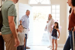 Three generation white family leaving their home to go on holiday, three quarter length, close up