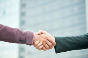Mature Business People Shaking Hands