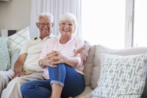 Portrait Of Senior Couple Relaxing On Sofa At Home Together