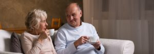 Elderly couple sitting on couch